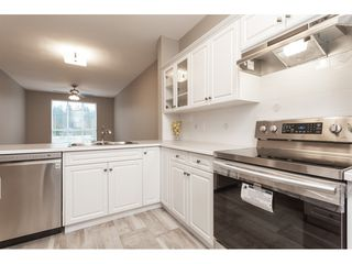 "Photo 8: #402 13860 70 Avenue in Surrey: West Newton Condo for sale in ""Chelsea Gardens"" : MLS®# R2435738"