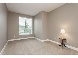 "Photo 14: #402 13860 70 Avenue in Surrey: East Newton Condo for sale in ""Chelsea Gardens"" : MLS®# R2435738"