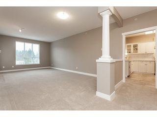"Photo 3: #402 13860 70 Avenue in Surrey: West Newton Condo for sale in ""Chelsea Gardens"" : MLS®# R2435738"