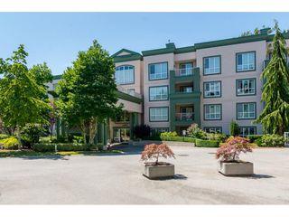 "Photo 1: #402 13860 70 Avenue in Surrey: West Newton Condo for sale in ""Chelsea Gardens"" : MLS®# R2435738"