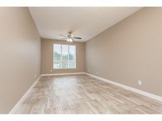 "Photo 10: #402 13860 70 Avenue in Surrey: East Newton Condo for sale in ""Chelsea Gardens"" : MLS®# R2435738"