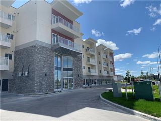 Photo 2: 413 1730 Leila Avenue in Winnipeg: Maples Condominium for sale (4H)  : MLS®# 202100121