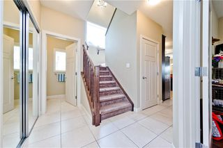Photo 4: 58 EVERHOLLOW MR SW in Calgary: Evergreen House for sale : MLS®# C4255811