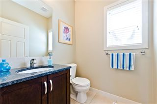 Photo 5: 58 EVERHOLLOW MR SW in Calgary: Evergreen House for sale : MLS®# C4255811
