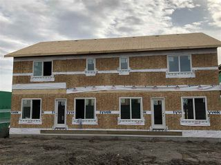 Photo 3: 8014 174 Avenue NW in Edmonton: Zone 28 House Half Duplex for sale : MLS®# E4173904