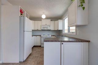 Photo 7: 39 Deerview Way SE in Calgary: Deer Ridge Semi Detached for sale : MLS®# A1051815