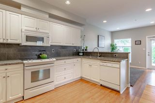 Photo 3: 4 1290 AMAZON DRIVE in Port Coquitlam: Riverwood Townhouse for sale : MLS®# R2315823