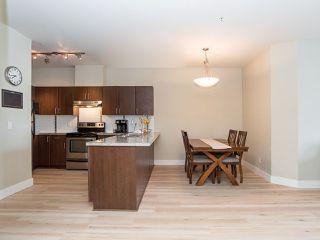 "Photo 3: 202 19830 56 Avenue in Langley: Langley City Condo for sale in ""Zora"" : MLS®# R2433877"