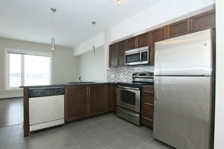 Photo 4: 2414 604 EAST LAKE Boulevard NE: Airdrie Apartment for sale : MLS®# A1016505