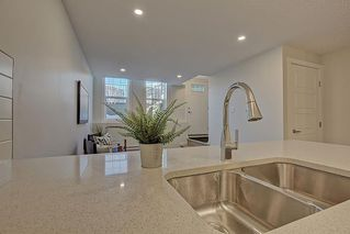 Photo 11: 126 Cranbrook Square SE in Calgary: Cranston Row/Townhouse for sale : MLS®# A1058399