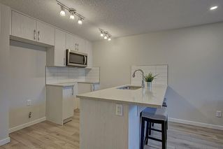 Photo 9: 126 Cranbrook Square SE in Calgary: Cranston Row/Townhouse for sale : MLS®# A1058399