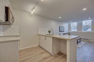 Photo 10: 126 Cranbrook Square SE in Calgary: Cranston Row/Townhouse for sale : MLS®# A1058399