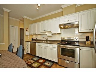 """Photo 5: 57 21579 88B Avenue in Langley: Walnut Grove Townhouse for sale in """"CARRIAGE PARK"""" : MLS®# F1228579"""