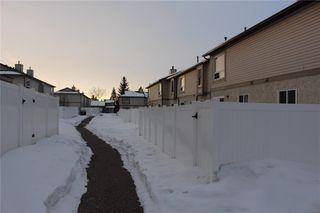 Photo 4: 226 DEERPOINT Lane SE in Calgary: Deer Ridge Row/Townhouse for sale : MLS®# C4282860