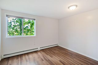Photo 11: 204 2022 CANYON MEADOWS Drive SE in Calgary: Queensland Apartment for sale : MLS®# A1028195