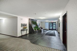 Photo 3: 204 2022 CANYON MEADOWS Drive SE in Calgary: Queensland Apartment for sale : MLS®# A1028195