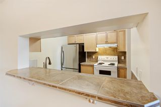 Photo 14: 204 2022 CANYON MEADOWS Drive SE in Calgary: Queensland Apartment for sale : MLS®# A1028195