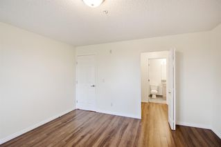 Photo 9: 204 2022 CANYON MEADOWS Drive SE in Calgary: Queensland Apartment for sale : MLS®# A1028195