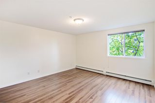 Photo 8: 204 2022 CANYON MEADOWS Drive SE in Calgary: Queensland Apartment for sale : MLS®# A1028195