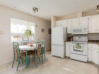 Photo 11: 231 Parkland Rise SE in Calgary: Parkland Detached for sale : MLS®# A1047149