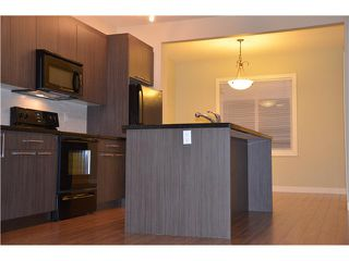 Photo 2: 106 300 MARINA Drive in : Chestermere Townhouse for sale : MLS®# C3632994