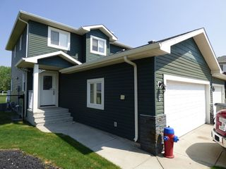Photo 1: 5, 520 Sunnydale Road in Morinville: House Half Duplex for rent