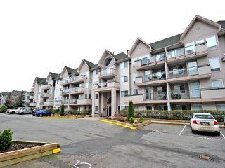 "Photo 1: 107 33738 KING Road in Abbotsford: Poplar Condo for sale in ""College Park"" : MLS®# F1301841"