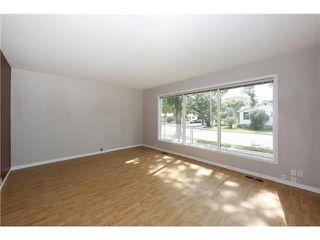 Photo 2: 3804 114 AV: Edmonton House for sale : MLS®# E3387285