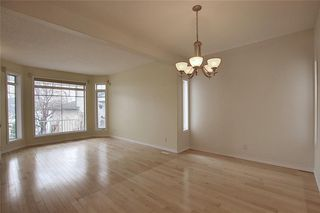 Photo 8: 243 ARBOUR CREST Road NW in Calgary: Arbour Lake Detached for sale : MLS®# C4295620