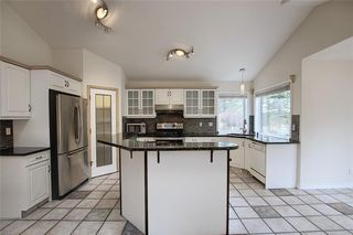 Photo 12: 243 ARBOUR CREST Road NW in Calgary: Arbour Lake Detached for sale : MLS®# C4295620
