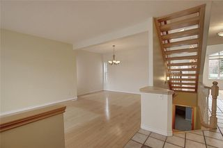 Photo 7: 243 ARBOUR CREST Road NW in Calgary: Arbour Lake Detached for sale : MLS®# C4295620