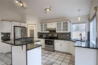 Photo 13: 243 ARBOUR CREST Road NW in Calgary: Arbour Lake Detached for sale : MLS®# C4295620