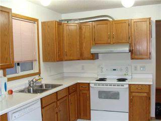 Photo 6: 128 RIVERGLEN Drive SE in CALGARY: Riverbend Residential Detached Single Family for sale (Calgary)  : MLS®# C3506059