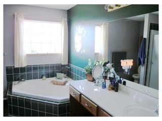 Photo 10: 66 WEST EDGE Road: Cochrane Residential Detached Single Family for sale : MLS®# C3525006
