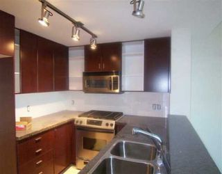 Photo 1: 415 6888 Southpoint Drive in Burnaby: South Slope Condo for sale (Burnaby South)  : MLS®# V599664