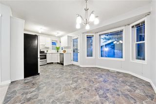 Photo 11: 167 BRIDLEWOOD CM SW in Calgary: Bridlewood House for sale