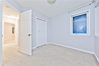 Photo 8: 167 BRIDLEWOOD CM SW in Calgary: Bridlewood House for sale