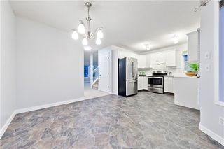 Photo 4: 167 BRIDLEWOOD CM SW in Calgary: Bridlewood House for sale