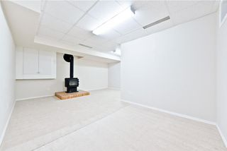 Photo 12: 167 BRIDLEWOOD CM SW in Calgary: Bridlewood House for sale