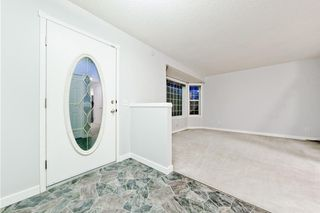 Photo 9: 167 BRIDLEWOOD CM SW in Calgary: Bridlewood House for sale