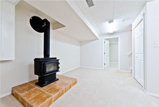 Photo 17: 167 BRIDLEWOOD CM SW in Calgary: Bridlewood House for sale