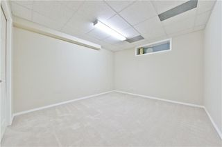 Photo 15: 167 BRIDLEWOOD CM SW in Calgary: Bridlewood House for sale