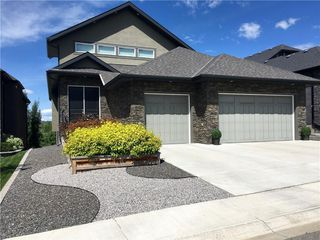 Photo 1: 106 ASPENSHIRE Drive SW in Calgary: Aspen Woods Detached for sale : MLS®# A1027893