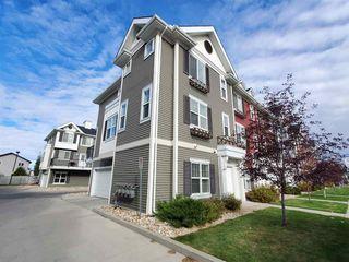 Photo 2: 79 8315 180 Avenue in Edmonton: Zone 28 Townhouse for sale : MLS®# E4213276