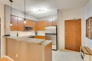 "Photo 3: 408 100 CAPILANO Road in Port Moody: Port Moody Centre Condo for sale in ""Suter Brook"" : MLS®# R2433615"