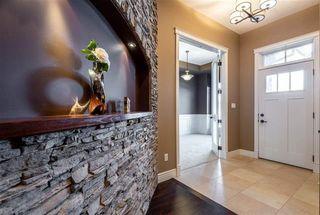 Photo 3: 184 AMBLESIDE Drive SW in Edmonton: Zone 56 Attached Home for sale : MLS®# E4190064